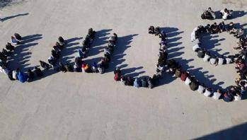 Öğrenciler ABD'ye tepki için Arapça 'Kudüs' yazdı