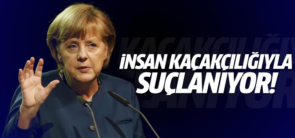 Merkel insan kaçakçılığıyla suçlanıyor
